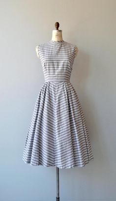 Vintage 1950s grey and white horizontal striped cotton dress with high neckline, bust darkts, sleeveless bodice, fitted waist, chevron stripe pattern on skirt and back fabric buttons. --- M E A S U R E M E N T S --- fits like: small bust: 36-38 waist: 26 hip: free length: 47 brand/maker: n/a condition: excellent to ensure a good fit, please read the sizing guide: http://www.etsy.com/shop/DearGolden/policy ✩ layaway is available for this item ✩ more vint...