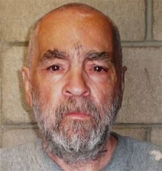 Charles Manson..wow he's getting so old. .could just be someone's grandpa. .minus the swastika of course lol