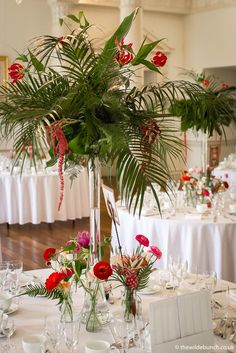 This Wilde Bunch Bride wanted a Tropical theme while retaining an element of 'Glamour' in the table centre designs at North Cadbury Court. The tall vases created exotic Palm trees and a perfect height (for conversation) on each table. Country House Wedding Venues, London Bride, Table Centers, Tall Vases, Palm Trees, Conversation, Centre, Wedding Flowers, Exotic
