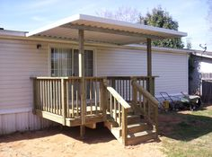 Mobile home front porch with metal cover, stairs and railing