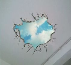 oh...my roof !!!  Don't worry ...it just 3D ceiling sticker ...Japanese is so creative ウォールステッカー壁穴から覗く青空3D風