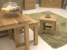 Nesting coffee tables.  http://www.worldstores.co.uk/p/Mobel_Nest_of_3_Oak_Coffee_Tables.htm