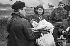 Bari, Italy. 17 January 1945. No. 267 Squadron RAF, a transport command squadron flying Douglas C47 Dakotas on supply missions to Yugoslavia, gives valuable aid to Tito's Partisans. Besides war supplies, food and clothes, the squadron takes in Yugoslav soldiers trained in Italy to carry on the fight against the retreating Germans, and former evacuees. Here a Yugoslav soldier and his six-week-old baby, are passangers on one trip, flown by an RAAF aircrew.