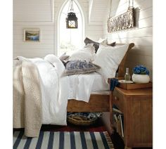 Valerie Floral Matelasse Duvet Cover & Sham | Pottery Barn; Blue and Ivory Pillow, and basket under bed