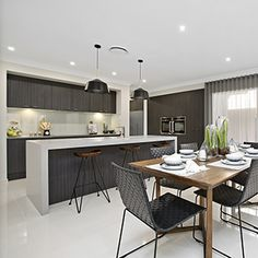Don't be scared to mix and match different wood/timber tones in a room. Kitchen by Metricon Homes - featured in the Bomenian 29RF Display Home.  #Interior #Design #Kitchen #Styling #NewHomeIdeas #Dining #Inspiration #Lighting #Benchtop #Sophisticated #WeeklyHomeTrends