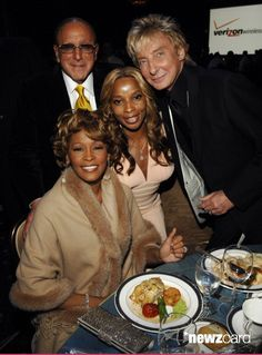 Clive Davis, Chairman and CEO BMG US, Barry Manilow, Whitney Houston and Mary J. Blige *EXCLUSIVE* ***Exclusive*** (Photo by L. Busacca/WireImage for J Records)