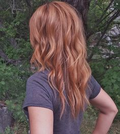 Dark copper hair color on medium to long hair length with loose curls (strawberry blonde), copper hair color for auburn ombre brown amber balayage and blonde hairstyles