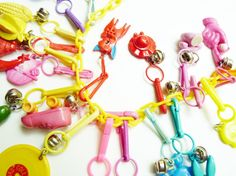 Wow!!! Take about bringing back memories. I loved my collection. Vintage Plastic 1980s Bell Charm Trinket Necklace by TheEpochYeti, $50.00