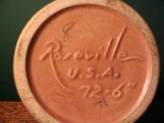 The Roseville Pottery Company was founded in 1890. Roseville initially produced simple utilitarian ware such as flower pots, stoneware, umbrella stands, cuspidors, and limited painted ware. In 1900, Roseville Rozane became the first high quality art pottery line produced by Roseville.    In 1904, Frederick Rhead became art director for Roseville pottery. Rhead was responsible for the production of scarce art pottery lines such as Fudji, Crystalis, Della Robbia, and Aztec…