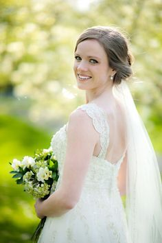 A stunning, happy bride. Image by Candace Berry Photography #weddingphotography #beautiful #bride #smiling