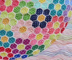 What a difference a thread weight can make! Geta from Geta's Quilting Studio shared her before and after photos of this spectacular quilt using #Aurifil 12wt to have more impact for on the background quilting and 50wt to blend in with the flowers that were made using Michael Miller Fabrics. To see more please visit http://cadouri-din-inima.blogspot.com/2014/11/colorful-applique-quilt.html