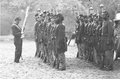 Mounting guard inspection, Fort Wagner, South Carolina April 1865. Civil War soldiers' guns were constantly inspected by NCOs for cleanliness and to ensure that movable parts, such as the hammer, were in working order.