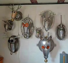 Silver trays & old metal become mounted animal trophies.