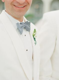 the #Groom in a navy checkered #bow-tie Photography: Lauren Kinsey Fine Art Wedding Photography - laurenkinsey.com Read More: http://stylemepretty.com/2013/10/21/key-west-wedding-from-lauren-kinsey/