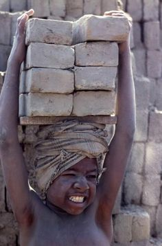 Children of the Dust. Lugging bricks, inhaling clay dust, India's untouchable boys trade their health for pittance in primitive brickyards. With no future besides work, they are victims of a society too poor to enforce child labour laws. by Eric Valli