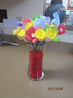 I made this tampon bouquet for my friends Hysterectomy party!  Everything you see is just tampons!  I attached floral wire with hot glue, painted them, and put them in a vase of red hots!   I wondered how I could repurpose my tampons!