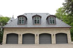 Four car garage with unfading black natural slate roof.