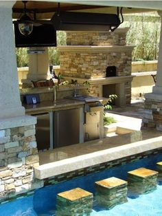 Pool goes right up to the bar (complete with stools and shelf!)