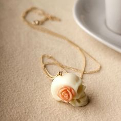 Wedding souvenir - vintage skull with pink rose - inexpensive . . . a fun idea for a Day of the Dead wedding theme