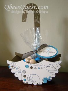 I created this umbrella favor box for a friend who was hosting a bridal shower.   She wanted the box in the shape of an umbrella and after p...