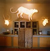 living4media - a wire and paper light sculpture of a cheetah above a rustic kitchen unit flanked by another pair of light sculptures all by the artist michael methven