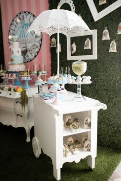 White tea car with lacy umbrella from this Alice in Wonderland Birthday Party at Kara's Party Ideas. See it all at karaspartyideas.com!