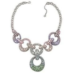 """Swarovski """"Rarely"""" Necklace.  Adorn yourself in a dazzling rainbow of crystal colors with this sixties-inspired statement necklace. The oversized, asymmetric links are embellished in bezel-set crystals in stunning pastel shades. This rhodium-plated design combines perfectly with the matching bangle. Size: 17 1/4 inch. $139 at swarovski-shop.me"""
