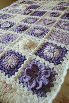 RESERVED Custom Order - Hearts in Bloom - Sampler Patchwork Granny Square Afghan - Baby Shower Gift. $70.00, via Etsy.