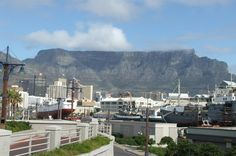 """Private Tour: Cape Town Mother City and Table Mountain Day Tour  After pick-up proceed to the oldest building in South Africa, Castle of Good Hope and carry on to the Main Street with the flower sellers and """"Company Gardens"""" part of the drive. St George's Cathedral associated with Bishop Desmond Tutu is next and stop for a pleasant walk in the Malay Quarters. Take the revolving Cable Car to the summit of Table Mountain for a circular walk on the mountain not to forget about th..."""