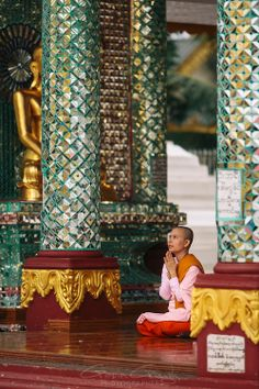 Buddhist nun meditating, Shwedagon Pagoda, Yangon, Myanmar