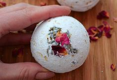 Perfect for handmade gifts, these bath bombs are made with essential oils and have a secret inner pocket of rose petals