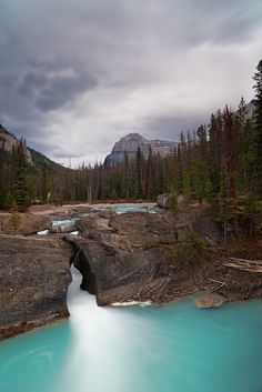 Natural Bridge Falls, Yoho National Park, British Columbia, Canada I was here in the fall and wow. I look like an ant standing on the bridge. It is such a magical place! Yoho National Park, Parc National, Oh The Places You'll Go, Places To Travel, Places To Visit, British Columbia, Rocky Mountains, Beautiful World, Beautiful Places