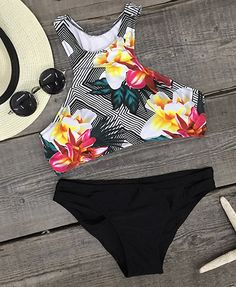 The night's calling and it wants you. The Tank Bikini Set with an adorable floral print, is an excellent choice for a day in the surf or sipping at the beach bar.
