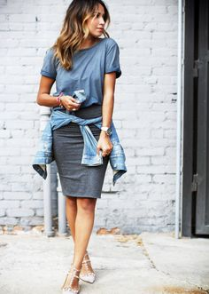 Julie Sarinana from Sincerely Jules wraps her denim jacket around her pencil skirt for a more casual feel. // #StreetStyle