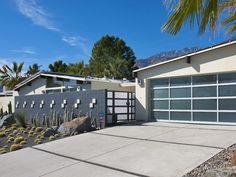 Love the professional landscaping. Hate the garage door.