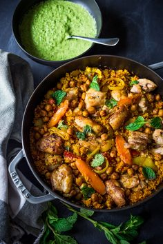 Delicious Tunisian Chicken ( or chickpeas) with Carrots, Cous Cous and flavorful Green Harissa Yogurt Sauce // chicken/chickpeas, carrots, Indian spices, tomatoes, dried apricots, couscous, parsley-jalapeno and yogurt sauce