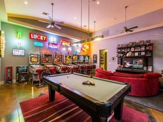 Get ready to lose track of time in this game room! From the arcade games to the pool table, this space is packed with everything that you need to have a good time. Teen Game Rooms, Game Room Kids, Game Room Bar, Video Game Rooms, Kids Room, Garage Game Rooms, Game Room Basement, Attic Game Room, Teen Basement