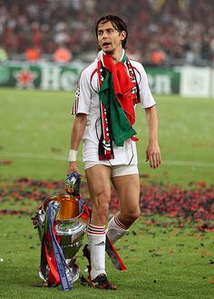 AC Milan's Filippo Inzaghi celebrates with the trophy on the pitch