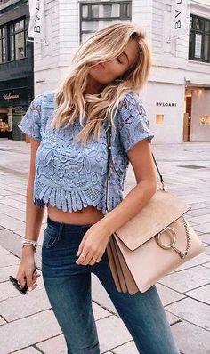 Light blue top, blue jean and nude shoulder bag.