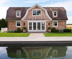 We love this classic Hamptons home! - Traditional Home®  Photo: Emily Followill Design: Lillian August