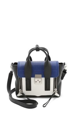 The classic 3.1 Phillip Lim Pashli mini satchel, updated in colorblock leather. Front zips open to expand the depth, and a button tab secures the rolled leather handles. - 3.1 Phillip Lim Pashli Mini Satchel