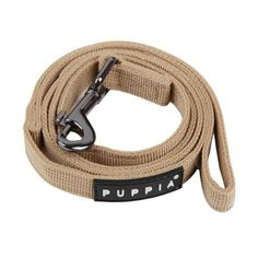 The Puppia Beige Two-Tone Dog Lead matches the best-selling Puppia Soft Harness in unparalleled style and quality. Made of 100% polyester, this authentic Puppia Two-Tone Dog Leash features inner and outer contrasting black and beige colors, a sturdy, nic