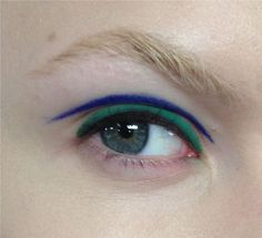 BOLD BLUE/GREEN LINER- clean, smooth, and bold. Please please keep this clean! Find a rich blue and an emerald green along with a bit of black for the lash line. Draw them on with intention and precision, shouldn't be too difficult. Wiggle the black into the lash line. REQUIRED: Rich royal blue, rich emerald green, black in lash line