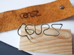 Make brand w wire and a wood block to burn into leather.