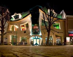 You might think this is the result of a heavy dose of Photoshop but it's actually for real. Crooked House, designed by Szotyńscy & Zaleski, is in a shopping center in Sopot, Poland, and was inspired by fairytale ilustrations.