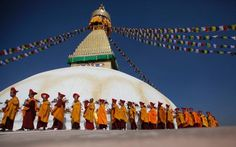 Buddhist monks circle around the Boudhanath Stupa during the last day of its purification ceremony in Kathmandu, Nepal.