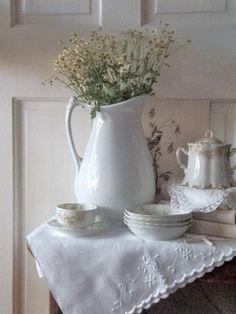 I have an antique pitcher just like this one.  Need to put flowers in it.