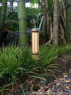 Bamboo lighting fixture use lrg bamboo to make & place into ground w/ Xmas lites inside to luminate walk