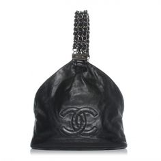 This is an authentic CHANEL Leather Mini Rock  Chain in Black.   This stylish tote is created of black calfskin leather.