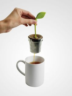 The tea leaf infuser looks like a pot of real tea plant.